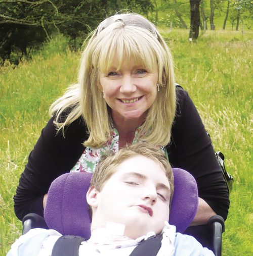 Author Jo Fitzgerald with her son, Mitchell, whose personal health budget has improved his quality of life